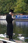Tashlikh is a Jewish practice that is performed during Rosh Hashanah (Jewish New Year). Men and women gather near a large body of flowing water and symbolically 'cast off' the previous year's sins by throwing pieces of bread into the water while reading a prayer (the last verses from the prophet Micah). In Stamford Hill the nearest flowing water is river Lea, Hackney, London.