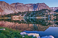 Sunrise reflections of the Snowy Range in Mirror Lake.  Wyoming, USA.