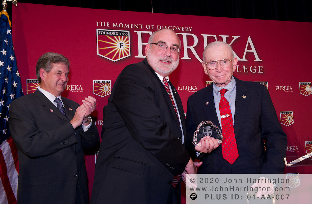 Retired U.S. Marine Corps Commandant General P.X. Kelley (right) receives an honorary fellowship from Eureka College President J. David Arnold (middle). Gen. Kelley served as the Marine Corps Commandant from July 1983 to June 1987. General Kelley was named as an honorary Ronald Reagan Fellow at the Centennial Celebration of Reagan's birthday held by his alma mater, Eureka College at a dinner event at the Reagan International Building in Washington, D.C. on November 9th, 2010.