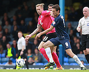 Southend player David Mooney and Peterborough United player Jack Collison compete for possession during the Sky Bet League 1 match between Southend United and Peterborough United at Roots Hall, Southend, England on 5 September 2015. Photo by Bennett Dean.