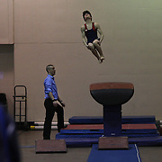 A coach watches a male vaulter in action during competition warm up during the 21st American Invitational 2014 competition at the XL Centre. Hartford, Connecticut, USA. USA. 31st January 2014. Photo Tim Clayton