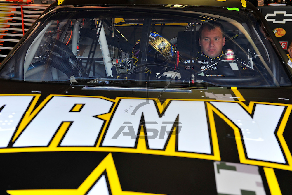 Brooklyn, MI - JUN 15, 2012: Ryan Newman (39) sits in his car in the garage during practice for the Quicken Loans 400 race at the Michigan International Speedway in Brooklyn, MI.