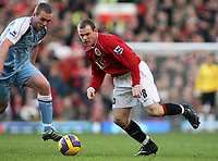 Photo: Paul Thomas.<br /> Manchester United v Manchester City. The Barclays Premiership. 09/12/2006.<br /> <br /> Wayne Rooney (R) of Man Utd gets past Richard Dunne of Man City.