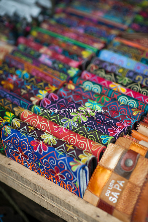 Colorful souvenir wallets in the markets of Sapa, Vietnam.