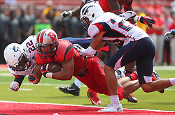 Sep 6, 2014; Piscataway, NJ, USA; Rutgers Scarlet Knights running back Paul James (34) dives for a touchdown during the first half at High Points Solutions Stadium.