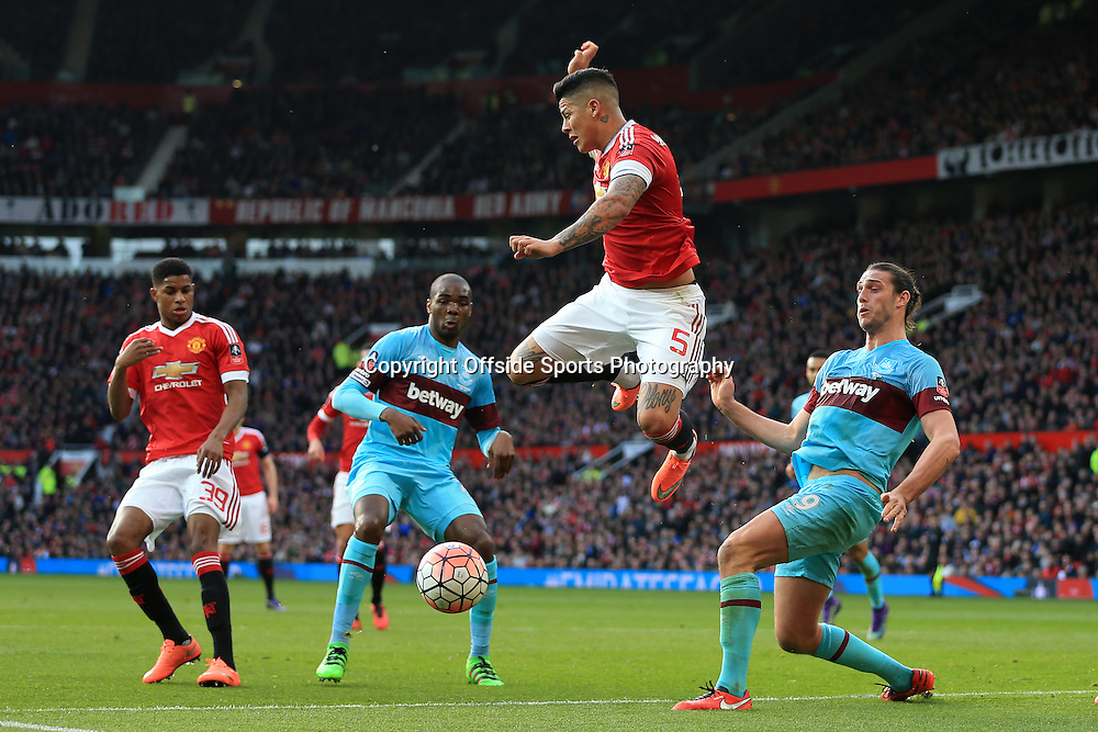 13th March 2016 - FA Cup - Quarter-Final - Manchester United v West Ham United - Marcos Rojo of Man Utd battles with Andy Carroll of West Ham - Photo: Simon Stacpoole / Offside.