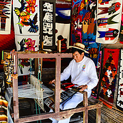 Man weaving in the museum of del sitio Ecuador,
