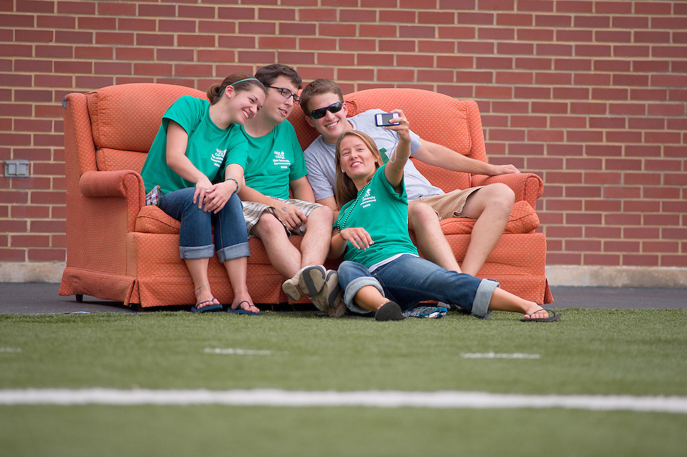 19058Homecoming 2008: Football Game OHIO vs. Virginia Military Institute. ..Couch sitters..Britney Gedeon(green head band), Jordan Bell(glasses), and Tim Churchmack(sunglasses)
