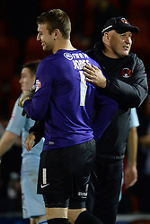 Leyton Orient's Jamie Jones gets congratulated by Leyton Orient Manager, Russell Slade after the penalty shoot out - Photo mandatory by-line: Mitchell Gunn/JMP - Tel: Mobile: 07966 386802 08/10/2013 - SPORT - FOOTBALL - Brisbane Road - Leyton - Leyton Orient V Coventry City - Johnstone Paint Trophy