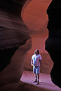 Navajo Guide in Upper Antelope Canyon, Page, Arizona. ..Subject photograph(s) are copyright Edward McCain. All rights are reserved except those specifically granted by Edward McCain in writing prior to publication...McCain Photography.211 S 4th Avenue.Tucson, AZ 85701-2103.(520) 623-1998.mobile: (520) 990-0999.fax: (520) 623-1190.http://www.mccainphoto.com.edward@mccainphoto.com