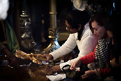 19 April 2019, Jerusalem: Women mark Good Friday (Western tradition), praying by the Stone of Anointing, where Jesus is said to have been prepared for burial after his crucifixion.
