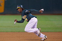 June 28, 2011; Oakland, CA, USA; Oakland Athletics second baseman Jemile Weeks (19) runs to second base against the Florida Marlins during the eighth inning at the O.co Coliseum.  Oakland defeated Florida 1-0.