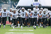 David Racine (#3) and the Cedar Ridge football team run out onto Dragon Stadium field to play the Stony Point Tigers Friday.  (LOURDES M SHOAF for Round Rock Leader.)