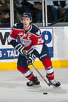 KELOWNA, CANADA - MARCH 22: Mitch Topping #25 of the Tri-City Americans looks for the pass against the Kelowna Rockets on March 22, 2014 during game 1 of the first round of WHL Playoffs at Prospera Place in Kelowna, British Columbia, Canada.   (Photo by Marissa Baecker/Getty Images)  *** Local Caption *** Mitch Topping;