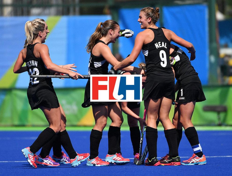 CORRECTION - New Zealand's players celebrate at the end of the women's quarterfinal field hockey New Zealand vs Australia match of the Rio 2016 Olympics Games at the Olympic Hockey Centre in Rio de Janeiro on August 15, 2016. / AFP / Pascal GUYOT / The erroneous mention[s] appearing in the metadata of this photo by Pascal GUYOT has been modified in AFP systems in the following manner: [New Zealand] instead of [Australia]. Please immediately remove the erroneous mention[s] from all your online services and delete it (them) from your servers. If you have been authorized by AFP to distribute it (them) to third parties, please ensure that the same actions are carried out by them. Failure to promptly comply with these instructions will entail liability on your part for any continued or post notification usage. Therefore we thank you very much for all your attention and prompt action. We are sorry for the inconvenience this notification may cause and remain at your disposal for any further information you may require.        (Photo credit should read PASCAL GUYOT/AFP/Getty Images)