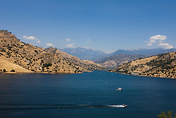 Boats cross Kaweah Lake, south of Sequoia National Park, near Lemon Cove, California, United States of America.