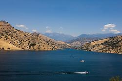 Boats cross Kaweah Lake, south of Sequoia National Park, near Lemon Cove, California, United States of America.
