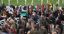 Horses come back in after the Simplify Horse Racing Selections With Betfinder At Betbright Handicap Hurdle during the New Year Meeting at Cheltenham Racecourse.