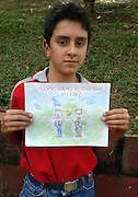 Atanasio Girardot School, Girargota, Antioquia, Colombia.<br /> This public school of 1,530 primary and secondary students has, like other schools in the province, a curriculum which includes classes and projects focussing on themes of coexistence, peace and nonviolence.<br /> Andres Palacio, 12, of the 8th class drawing an assignment called &quot;How do I dream of Colombia in Peace&quot;.