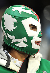 A Paraguay fan wears a wrestlers mask during the 2010 FIFA World Cup South Africa Group F match between Italy and Paraguay at Green Point Stadium on June 14, 2010 in Cape Town, South Africa.