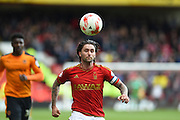 Nottingham Forest midfielder Henri Lansbury (10) during the Sky Bet Championship match between Nottingham Forest and Wolverhampton Wanderers at the City Ground, Nottingham, England on 30 April 2016. Photo by Jon Hobley.