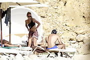 IBIZA, SPAIN, 2016, JUNE 29 <br /> <br /> Luis Figo has again chosen the island of Ibiza to enjoy his summer vacation with his wife, Helen Svedin, and their three daughters, Daniela, Martina and Stella. The couple arrived to the Balearic island on a yacht. We can see how they enjoy the crystal clear waters of Ibiza, his daughters are as beautiful as the mother and are very aware of his father. A very close family, enjoying a nice holiday in Ibiza and Formentera iIslas. He has been portrayed arrival at the beach in jeans and shirt, which quickly changed to a more beachy bikini and sunglasses look. The whole family enjoy a swim, where we could see that it was player keeps his athletic body and the model is not indifferent to the great guy that looks. Luis I take the quiet of the beach to enjoy reading.<br /> ©Exclusivepix Media
