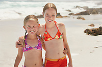 Two girls (7-9 10-12) posing on beach portrait