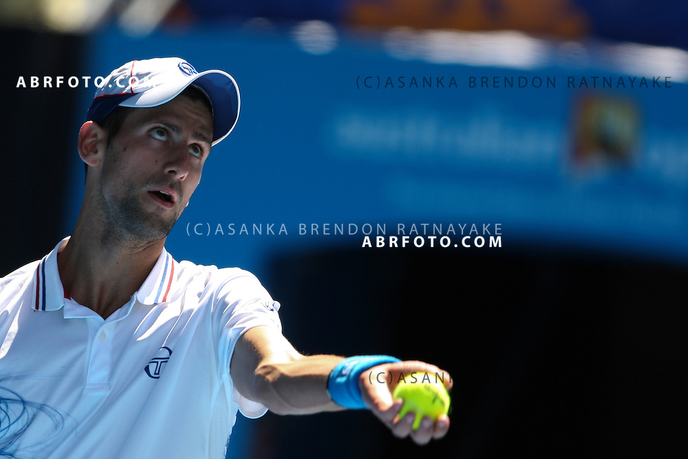 19 January 2012 : Novak Djokovic (SRB) in his 2nd round match against Santiago Giraldo (COL) about to serve during Day 4 round 2 of the Australian Tennis open grand slam event at Melbourne Park, Melbourne Australia.