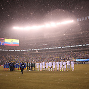 Team line up a snow storm during the Argentina Vs Ecuador International friendly football match at MetLife Stadium, New Jersey. USA. 31st march 2015. Photo Tim Clayton