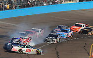 Nov. 15, 2009; Avondale, AZ, USA; NASCAR Sprint Cup Series driver Dale Earnhardt Jr. spins during the Checker O'Reilly Auto Parts 500 at Phoenix International Raceway. Mandatory Credit: Jennifer Stewart-US PRESSWIRE