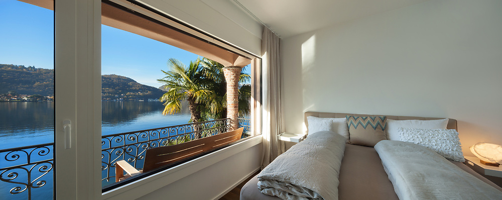 Nice bedroom with large window, view of the lake