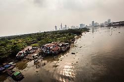 Substandard dwellings seen from Thu Thiem bridge, Ho Chi Minh City, Vietnam, Southeast Asia
