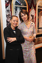 Left to right, RACHEL HARDING and BETTINA TRAUB at a pre lunch reception to celebrate the launch of the new Louisa Guinness gallery at Ben Brown Fine Art, Cork Street, London on 18th November 2009.