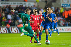 SWANSEA, ENGLAND - Friday, September 4, 2009: Wales' Aaron Ramsey and Italy's goalkeeper Vincenzo Fiorllo and Giuseppe Bellusci during the UEFA Under 21 Championship Qualifying Group 3 match at the Liberty Stadium. (Photo by Gareth Davies/Propaganda)
