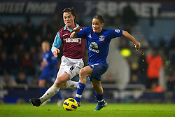 LONDON, ENGLAND - Tuesday, December 28, 2010: Everton's Steven Pienaar and West Ham United's Scott Parker during the Premiership match at Upton Park. (Pic by: David Rawcliffe/Propaganda)
