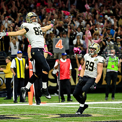 Oct 16, 2016; New Orleans, LA, USA; New Orleans Saints tight end Coby Fleener (82) celebrates after a touchdown against the Carolina Panthers during the first quarter of a game at the Mercedes-Benz Superdome. Mandatory Credit: Derick E. Hingle-USA TODAY Sports