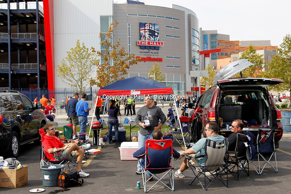 General view of fans tailgating outside of Gillette Stadium prior to the New England Patriots NFL regular season week 3 football game against the Buffalo Bills on September 26, 2010 in Foxborough, Massachusetts. The Patriots won the game 38-30. (©Paul Anthony Spinelli)