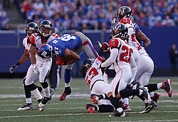 Nov 22, 2009; East Rutherford, NJ, USA; New York Giants wide receiver Domenik Hixon (87) is hit by Atlanta Falcons linebacker Mike Peterson (53) during the first half at Giants Stadium. Mandatory Credit: Ed Mulholland
