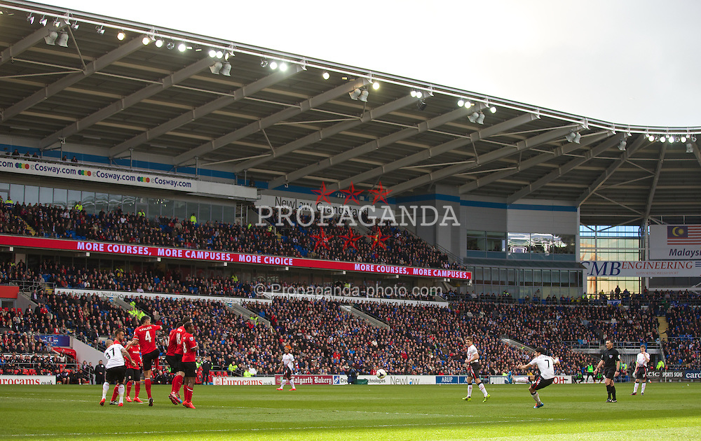 CARDIFF, WALES - Saturday, March 22, 2014: Liverpool's Luis Suarez takes a free-kick against Cardiff City during the Premiership match at the Cardiff City Stadium. (Pic by David Rawcliffe/Propaganda)