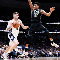 01 April 2018: Denver Nuggets forward Juan Hernangomez (41) drives past Milwaukee Bucks forward Giannis Antetokounmpo (34) during the Denver Nuggets 128-125 victory over the Milwaukee Bucks, at the Pepsi Center, Denver, Colorado, USA.