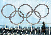 2/8/06 -- The 2006 Torino Winter Olympics -- Sestriere , Italy..A worker at the Sestriere Colle venue, home to the Slalom and Giant Slalom alpine ski races, inspects the banner of the olympic rings at the top of the public viewing stands...Photo by Scott Sady, USA TODAY staff.