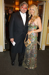 MR ROBERT TCHENGUIZ and MISS HEATHER BIRD wearing Christian LeCroix at the 25th annual Awards of the London Film Critics' Circle in aid of the NSPCC held at The Dorchester Hotel, Park Lane, London W1 on 9th February 2005.<br />