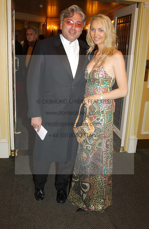 MR ROBERT TCHENGUIZ and MISS HEATHER BIRD wearing Christian LeCroix at the 25th annual Awards of the London Film Critics' Circle in aid of the NSPCC held at The Dorchester Hotel, Park Lane, London W1 on 9th February 2005.<br /><br />NON EXCLUSIVE - WORLD RIGHTS