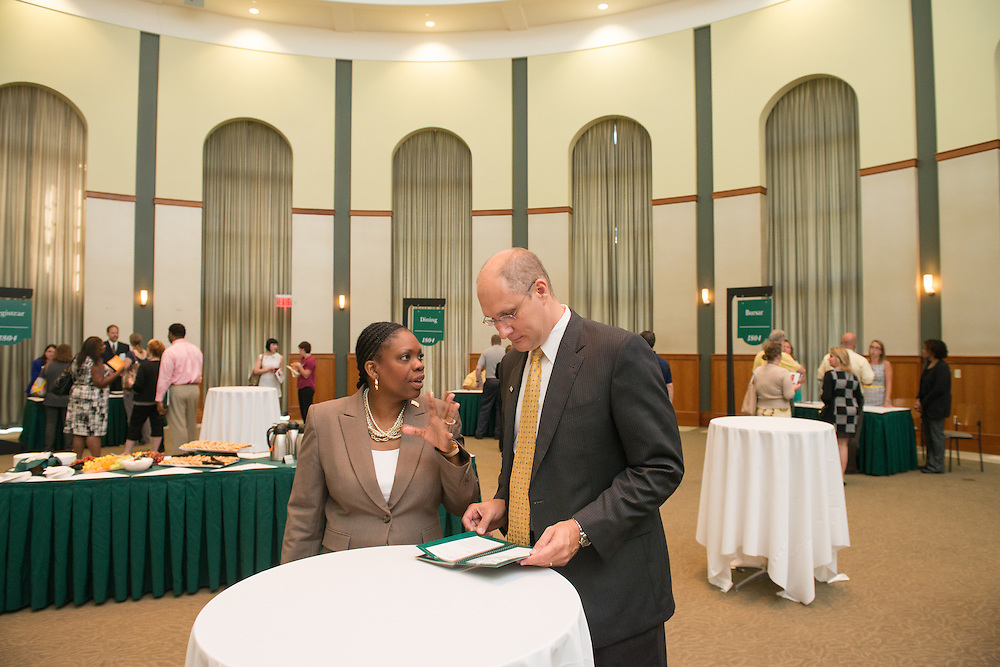 Executive Director of University Communications and Marketing Renea Morris (Left) talks with Vice Provost for Enrollment Management Craig Cornell at the Your Passport to the OHIO Guarantee. Photo by Ben Siegel/ Ohio University