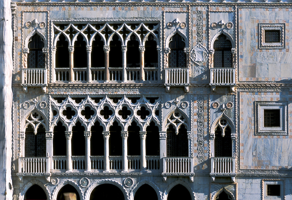 Restored Ca' d'Oro facade, on the Grand Canal, Venice.  View of the two upper floors with their Gothic arcades.  Built 1428-1430 for the Contarini family. Architect Giovanni Bon.  Sculptor his son Bartolomeo Bon.