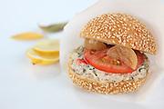 Tuna salad sandwich with tomato and lemon