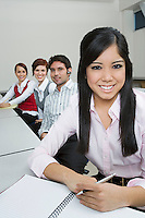 Cheerful Multi Racial Group of Business people Sitting at Desk