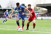 Lyle Taylor forward for AFC Wimbledon (33) tussles with Crawley Town Defender Joe McNerney (5) during the Sky Bet League 2 match between AFC Wimbledon and Crawley Town at the Cherry Red Records Stadium, Kingston, England on 16 April 2016. Photo by Stuart Butcher.