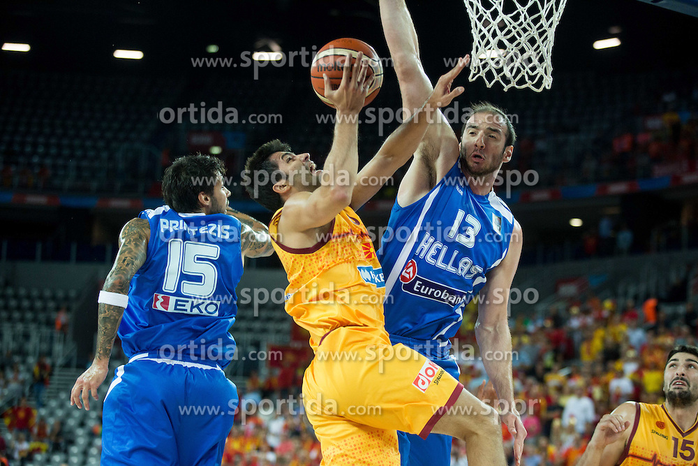 Vojdan Stojanovski of Macedonia between Georgios Printezis of Greece and Kostas Koufos of Greece during basketball match between FYR of Macedonia and Greece at Day 1 in Group C of FIBA Europe Eurobasket 2015, on September 5, 2015, in Arena Zagreb, Croatia. Photo by Vid Ponikvar / Sportida