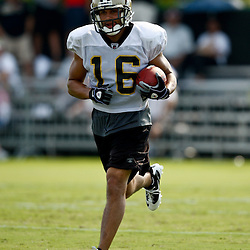 August 1, 2010; Metairie, LA, USA; New Orleans Saints wide receiver Lance Moore (16) runs with the ball during a training camp practice at the New Orleans Saints practice facility. Mandatory Credit: Derick E. Hingle